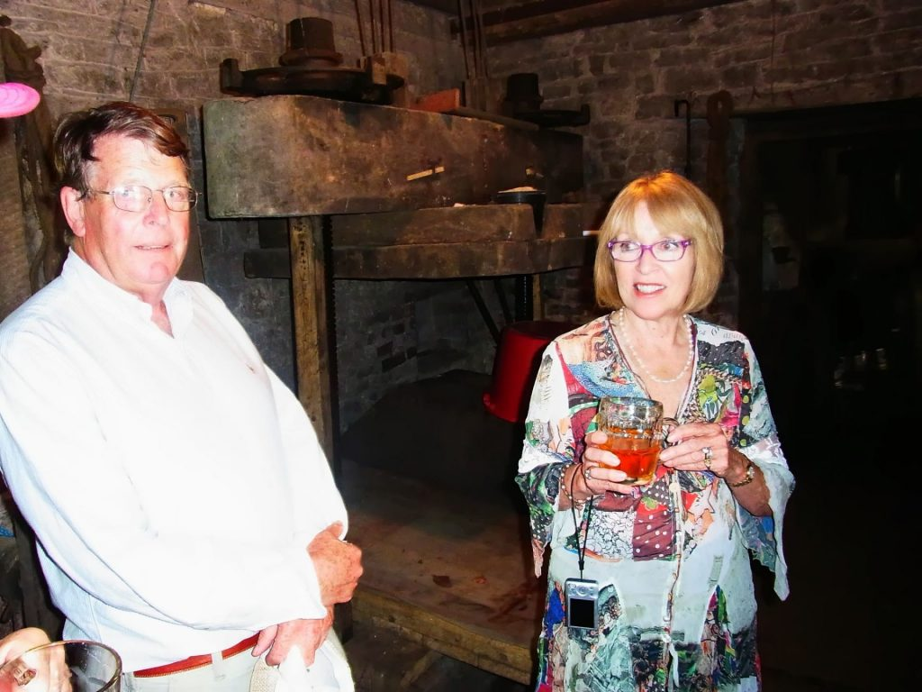 Peter and Gail Isaac near the cider press